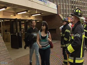 Passengers walk past firefighters at a Green Line station in Boston after the trolley collision in May.