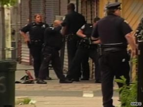 Police officers gather at the site of a shootout in Jersey City, New Jersey, on Thursday.