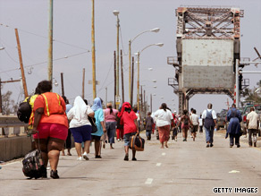 Katrina evacuees cross the Industrial Canal. The FBI is investigating a 2005 shooting at the Danziger Bridge.