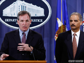 U.S. Attorney Patrick Fitzgerald, left, and Attorney General Eric Holder announce the indictments Thursday.