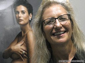Annie Leibovitz appears before her photo of Demi Moore during an exhibition of her work in June in Madrid, Spain.