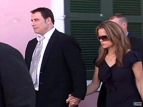 John Travolta and Kelly Preston leave a courthouse in the Bahamas Wednesday.