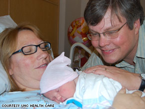 Shannon Eubanks and her husband admire their new baby, Kathleen.