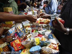 Shoppers in Ivory Coast buy counterfeit medicine at a street market.