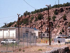 Officials are trying to determine the source of beryllium found at Los Alamos National Laboratory.