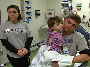 Two-year-old Talan, with Trisha and Jeremy Williamson, has been battling a recurring MRSA infection.