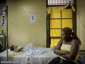 A mother and child in the recovery room of Trinite Hospital in Port-au-Prince, Haiti.