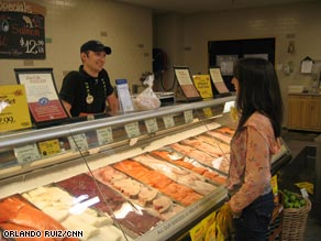 "Jackie Kaminer contemplates fish choices; she  buys only ""safe"" fish, like salmon, haddock and tilapia."