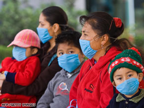 Quarantine officials at the Narita, Japan, airport go Wednesday to meet planes arriving from Mexico.