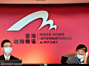Airline employees in Hong Kong work Saturday, a day after officials there confirmed their first case of swine flu.