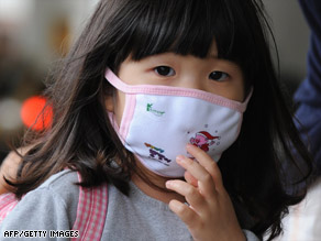 Don't pack your face masks just yet. Public health officials expect the 2009 H1N1 virus to linger a while.