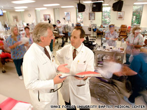 Dr. Barry Freedman, right, speaks with a colleague in a dialysis center at Wake Forest Baptist Medical Center.