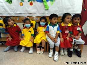 Kindergarten students, some wearing masks, attend school in a residential estate in Hong Kong on Thursday.