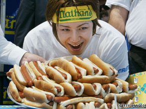 In last year's competition, Joey Chestnut celebrated his win and Kobayashi showed off his very full stomach.