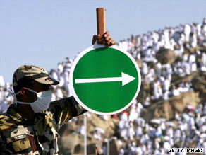 December 2008: A Saudi policeman directs pilgrims at Mount Arafat, southeast of holy city of Mecca.