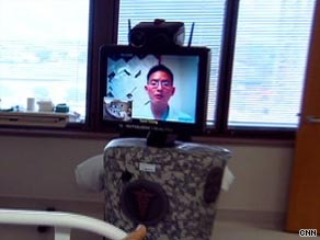 Dr. Kevin Chung appears on the screen of the robot that helps him treat soldiers from afar.