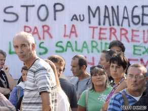 France Telecom employees protest against work conditions following a colleague's suicide.