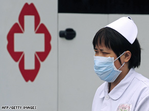 A nurse wears a mask Monday at a hospital in the Chinese city of Chengdu.