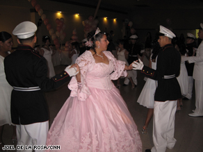 Jasmine Rocha dances with two cadets at her quincea�era.
