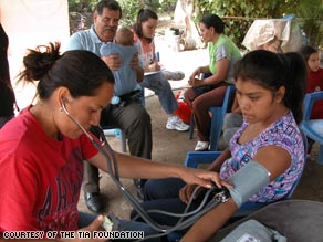 Community health workers, or promotoras, in El Reparo, Mexico, take patients' blood pressure.
