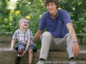 Noah Parton, 6, got prosthetics from foundation started by Jordan Thomas, right.