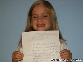 Meagan Bilodeau, 8, of Massachusetts holds a copy of the letter she sent in the bottle.