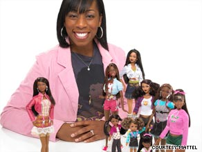 Stacy McBride-Irby, creator of the new Barbie, poses with the dolls.