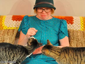 Two cats are OK, says writer, but having more may move you into questionable territory.