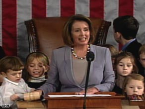 Speaker Nancy Pelosi, surrounded by her grandchildren, swears in the members of the House.