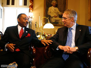 Roland Burris, left, meets with Senate Majority Leader Harry Reid in the Capitol on Wednesday.