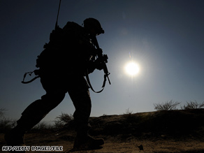 A U.S. soldier patrols in a village north of Kabul, Afghanistan, last month.