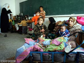 Palestinians take refuge in a United Nations aid shelter in Rafah, southern Gaza.