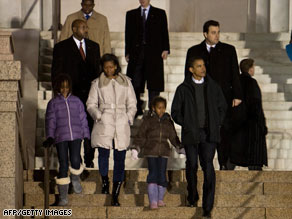 The Obama family walks down the steps of the Lincoln Memorial in Washington on Saturday.