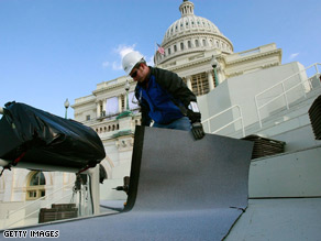 Workers are putting the finishing touches on the innaugural stage on the steps of U.S. Capitol.