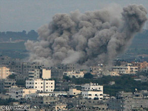 Smoke billows over Jabalya, Gaza, after an Israeli airstrike on Sunday.