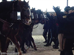 Police and horses practice crowd control techniques on Wednesday.