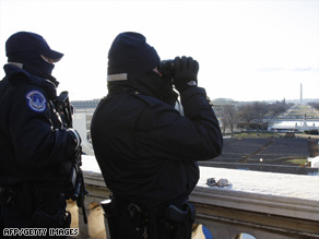 U.S. Capitol Police check observation positions in advance of Tuesday's presidential inauguration.