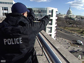 Security personnel keep watch at the U.S. Capitol ahead of the presidential inauguration.