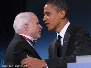 President-elect Barack Obama greets Sen. John McCain on stage after praising him at a bipartisan dinner.