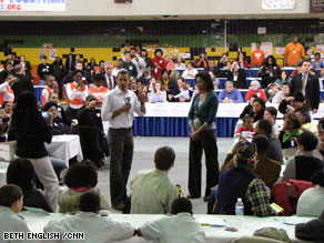 Obama, with his wife Michelle, addresses volunteers at a luncheon on Monday.