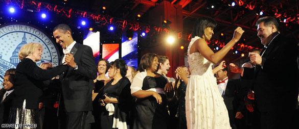 Obamas laugh, dance at inaugural balls