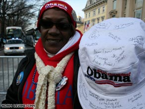 Margaret Trowelle of Jersey City, New Jersey, gets strangers to autograph an inauguration hat Tuesday.