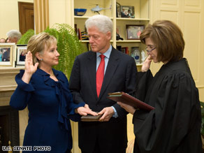Hillary Clinton gets sworn in Wednesday in her Senate office by Judge Kathryn Oberly.