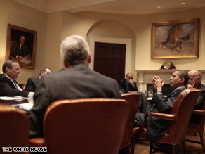 Members of the National Economic Council brief President Obama on the economy Wednesday.