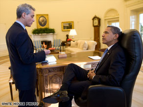 On his first complete day in office, President Obama talks with White House Chief of Staff Rahm Emanuel.