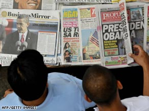 Readers browse newspapers Wednesday in the Philippines.