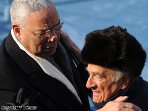 Colin Powell, left, embraces Nobel laureate Elie Wiesel at the inauguration Tuesday.