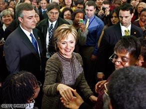 Secretary of State Hillary Clinton is welcomed to the State Department on Thursday.