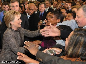Secretary of State Hillary Clinton greets staff members during her first day of work at the State Department.
