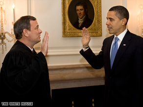 President Barack Obama takes the oath of office -- his second in two days -- in the White House on Wednesday.